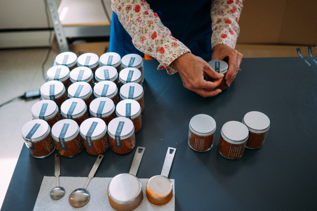 Autum packages spice jars and preps them for delivery
