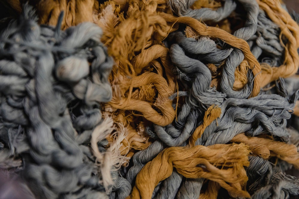 A closeup of blue and gold fiber strands.