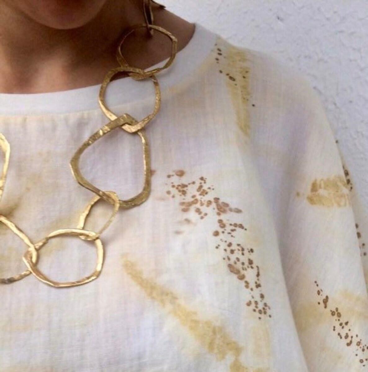 A big chain necklace from Mai Solorzano