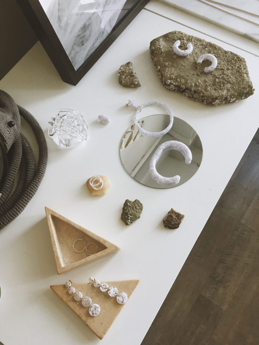 A selection of pieces from the Foe & Dear collection, including rings, earrings, and bracelets