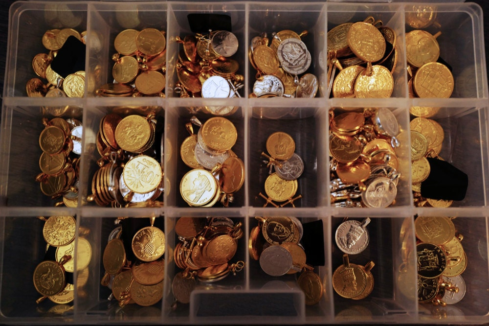 An organizer filled with coin pendants from different countries