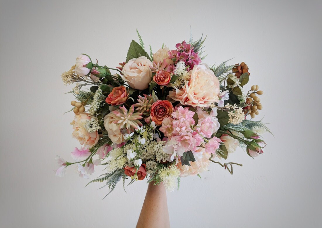 An example of a peachy pink bouquet with succulents from The Faux Bouquets