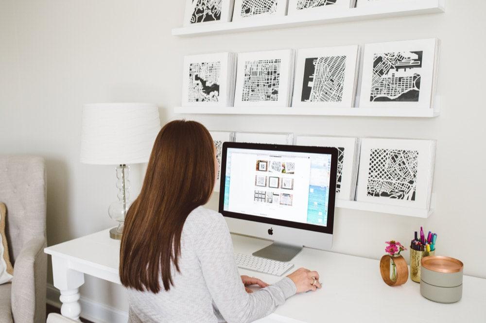 Karen working on her Etsy shop on her computer in her studio