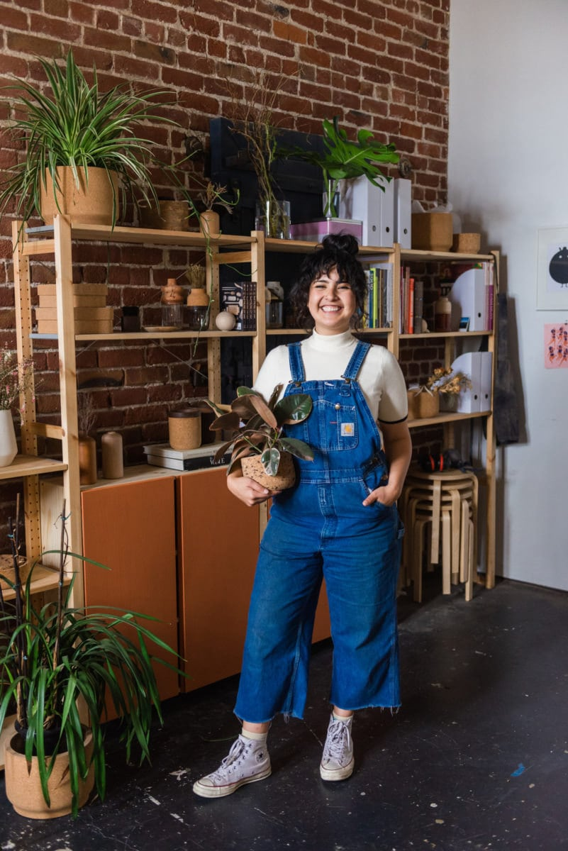 Melanie holding one of her cork planters in her studio