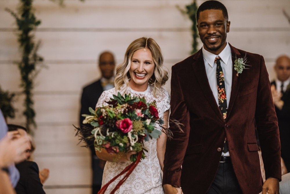 Emily and Terrell recess down the aisle after their I dos, all smiles