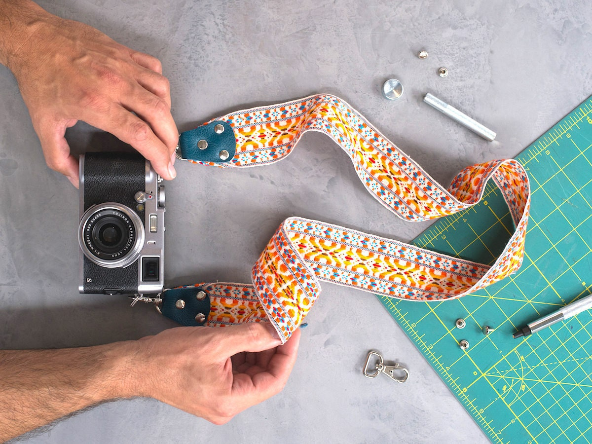 Finished colorful fabric DIY camera strap attached to vintage camera
