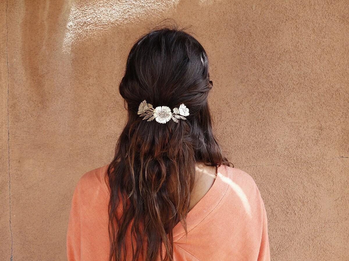 Almanac for June bronze poppy hair clip modeled