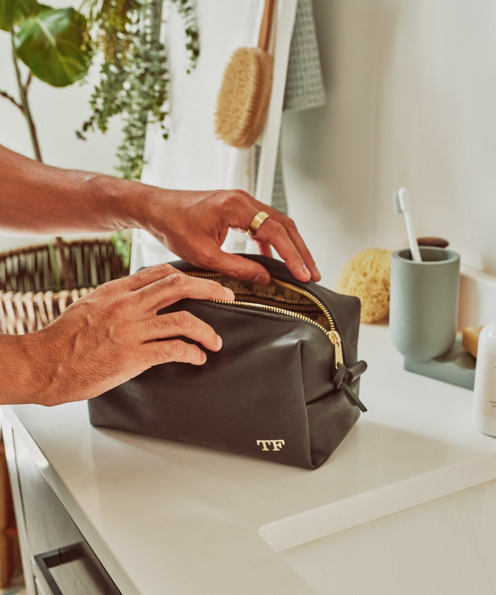 A monogrammed leather dopp kit from the Tan France x Etsy collection