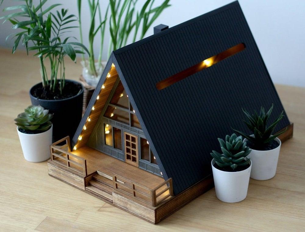 A wooden cabin-shaped wedding card box from Baraboshkin House