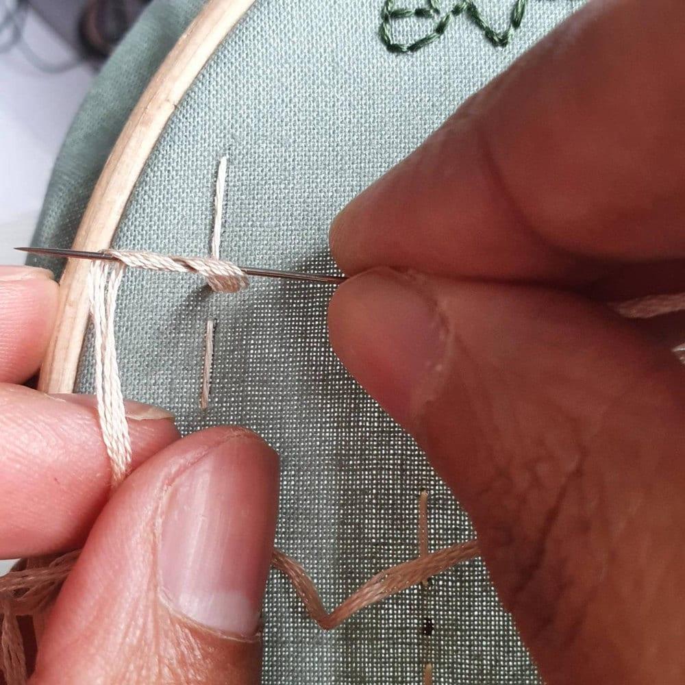 Natalie demonstrates a stitch.
