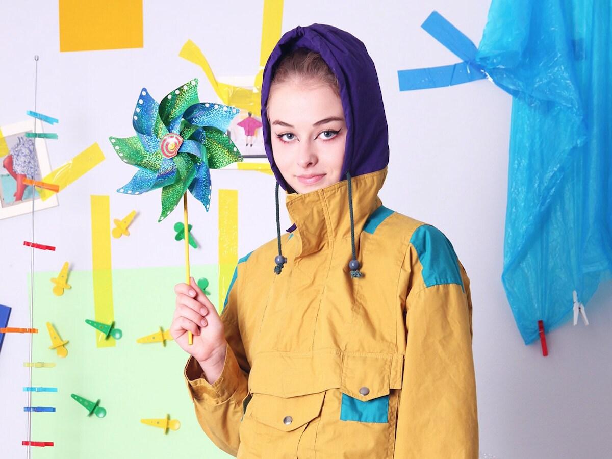 Woman modeling a mustard-colored 90s windbreaker from Old Wool
