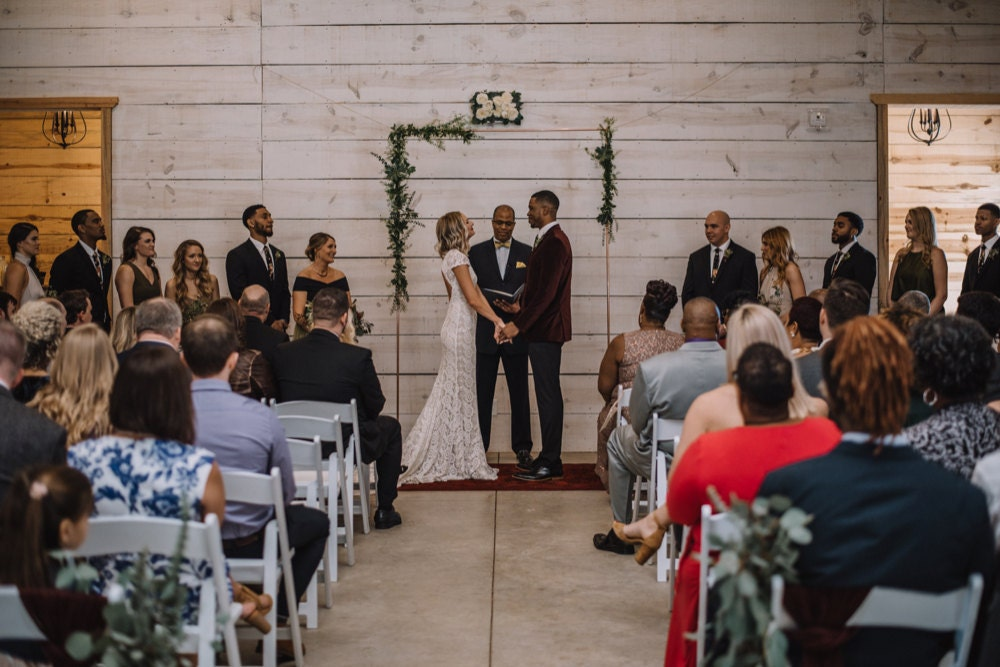 Emily and Terrell exchanging vows in front of their friends and family