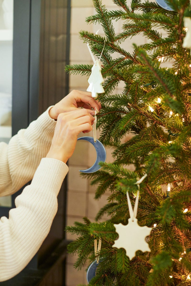 Crescent moon, snowflake, and tree-shaped ceramic ornaments from Hereafter