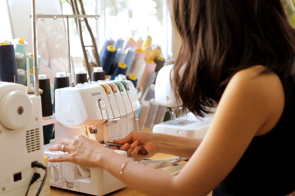 Elma at work on her sewing machine