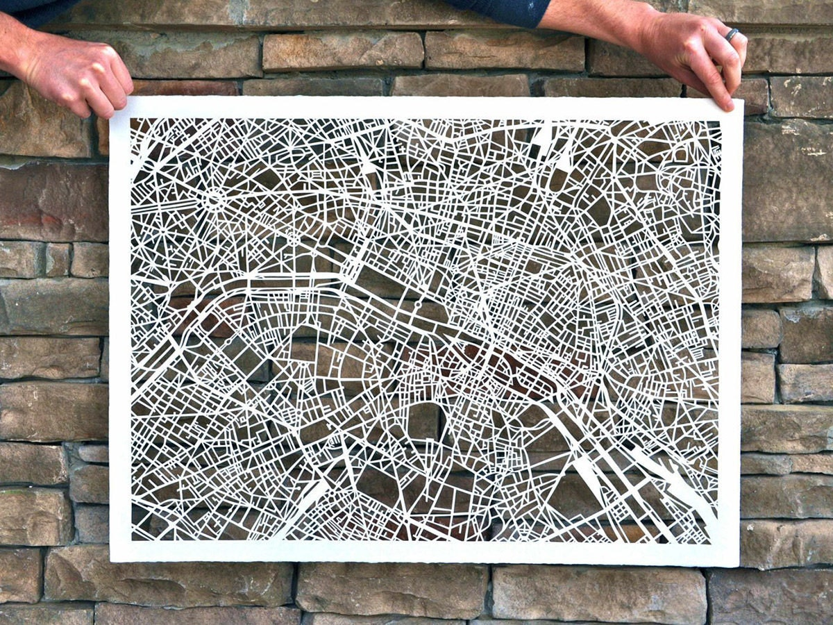 A large paper cut map of Paris from Studio KMO