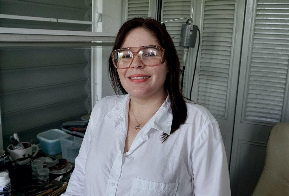 A portrait of jewelry designer and metalsmith Aleishla López in her Puerto Rico studio.