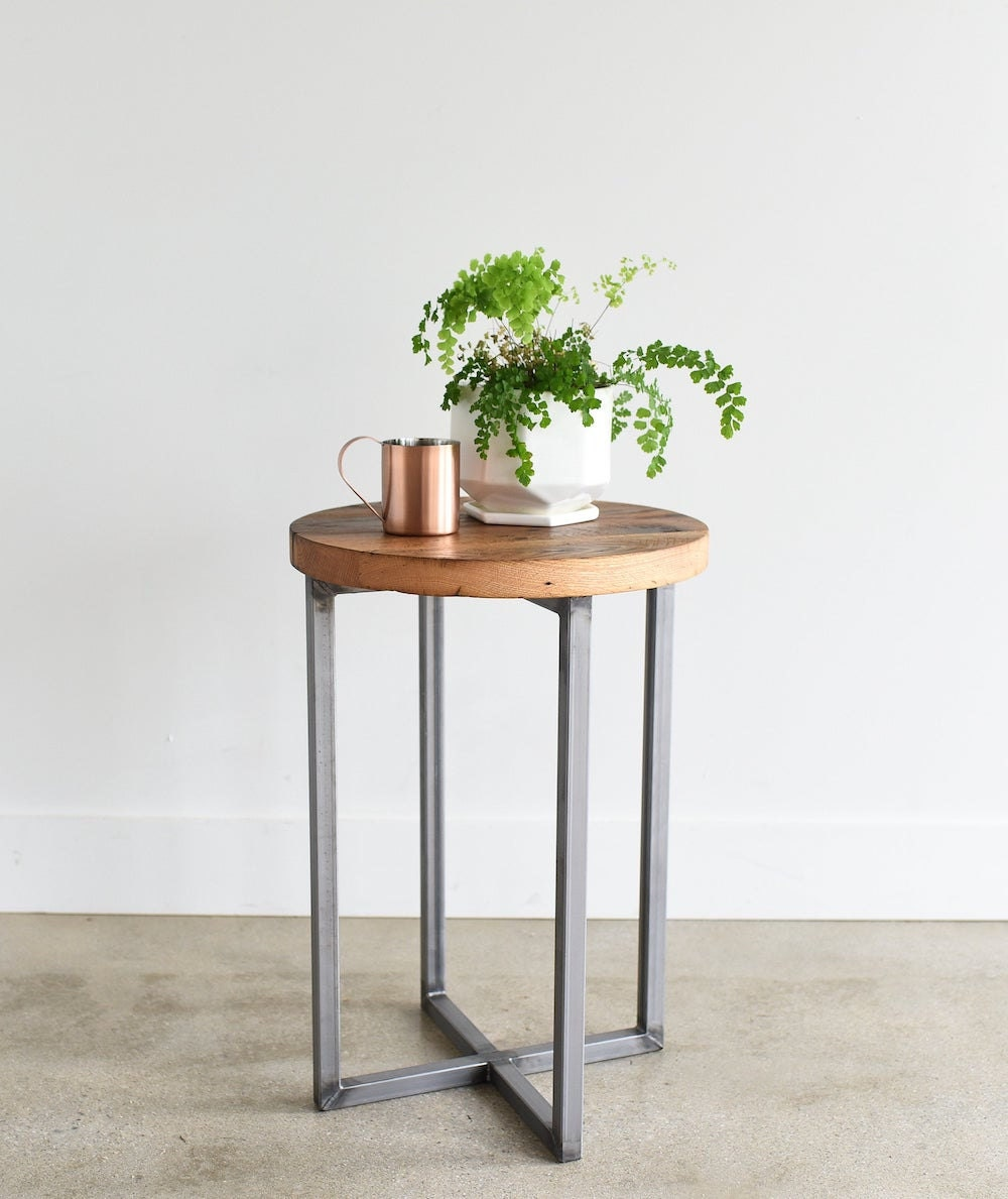 Round reclaimed wood end table with steel base from What WE Make