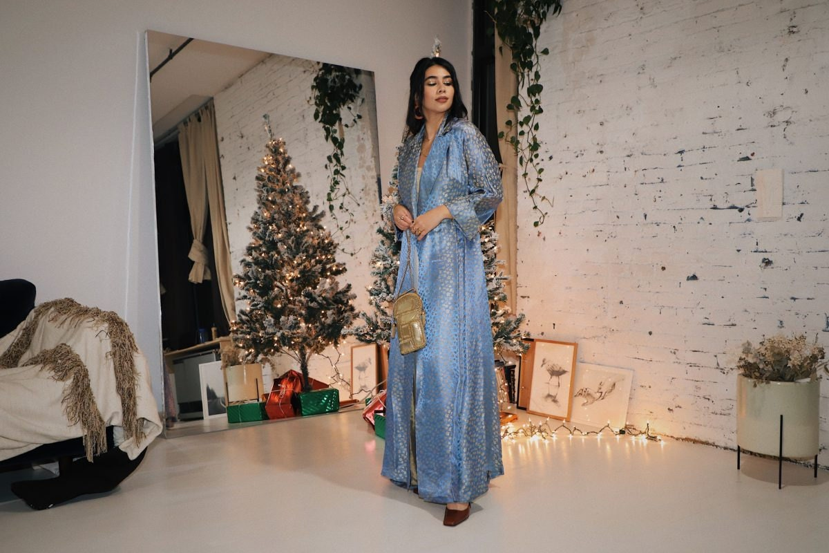 Tara Mazuki models a festive holiday party outfit from Etsy