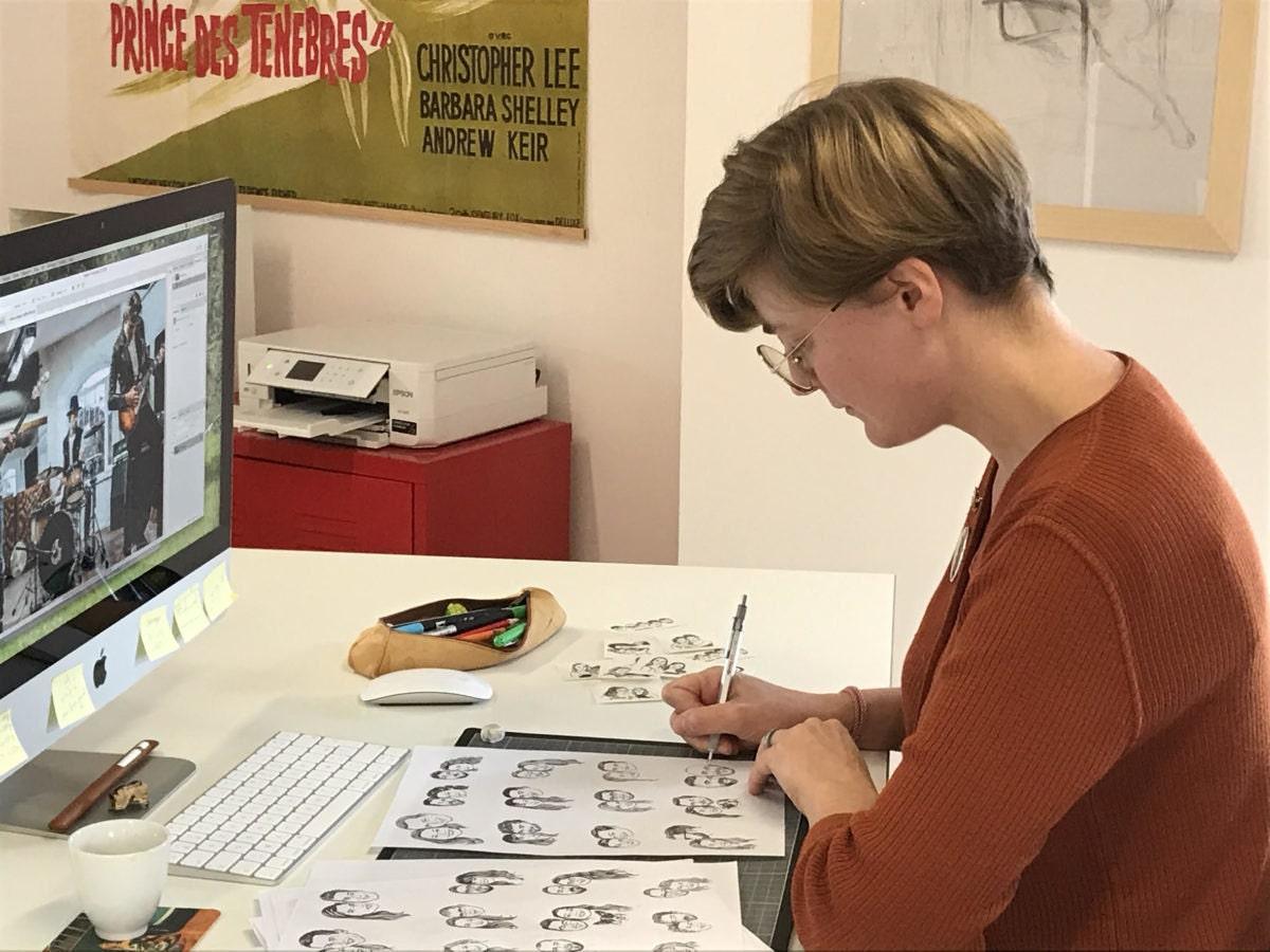 Lilimandrill shop owner Lise Grossmann sketching portraits in her studio.