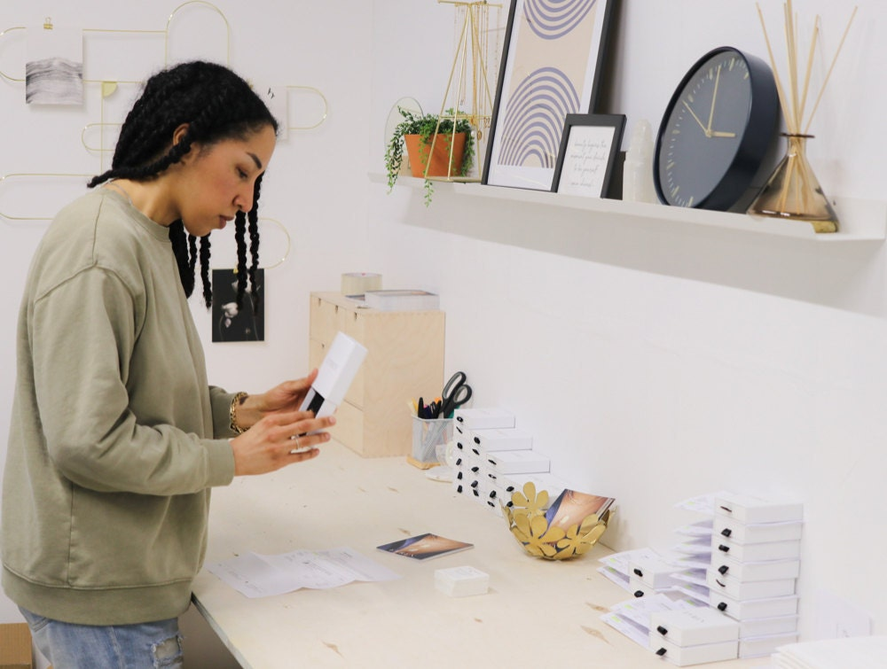 Sabrina packages up orders in her Vancouver studio space.