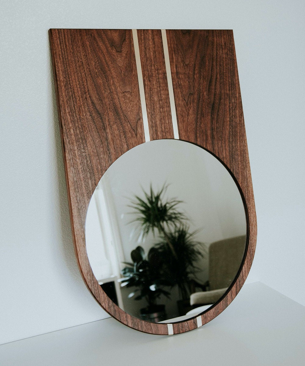 Wood-framed wall mirror from Szklo Glass