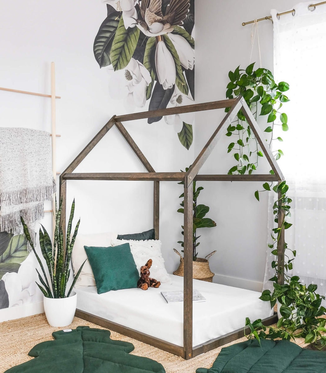 A house-shaped bed frame from KM Designs.