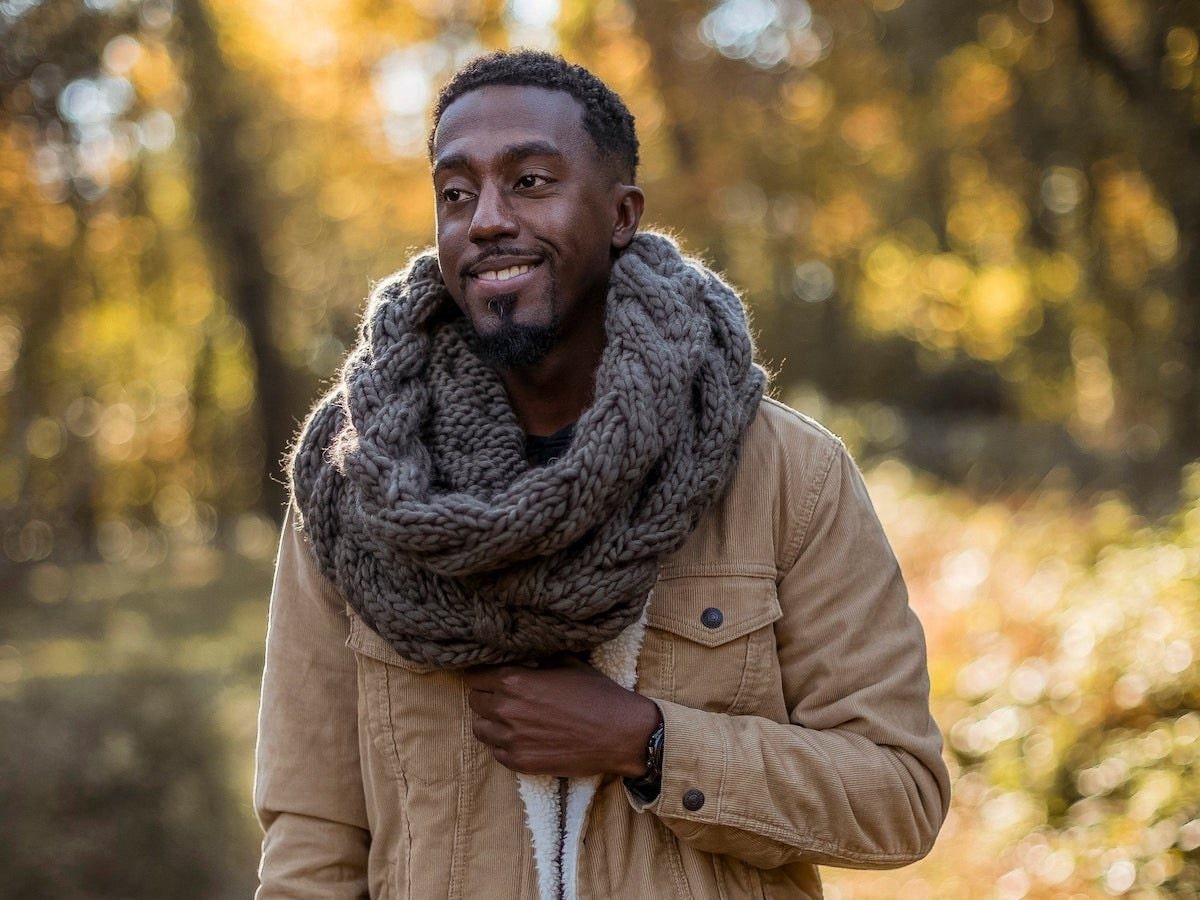 Knitwear designer and Loop'n Threads owner Nathan Bryant models one of his winter cowls