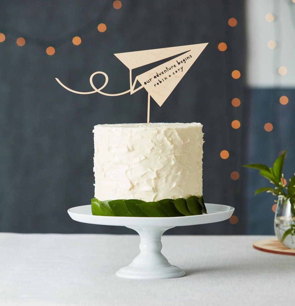 Personalized paper airplane wedding cake topper from Light + Paper