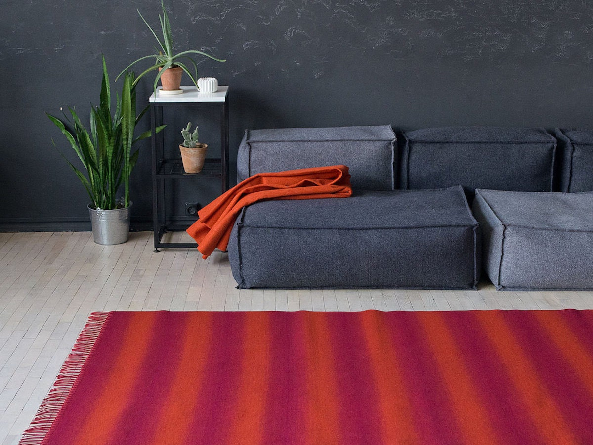 handmade red striped rug in a living room