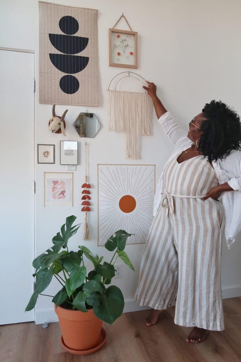 Janea hangs a sculptural fringed wall hanging
