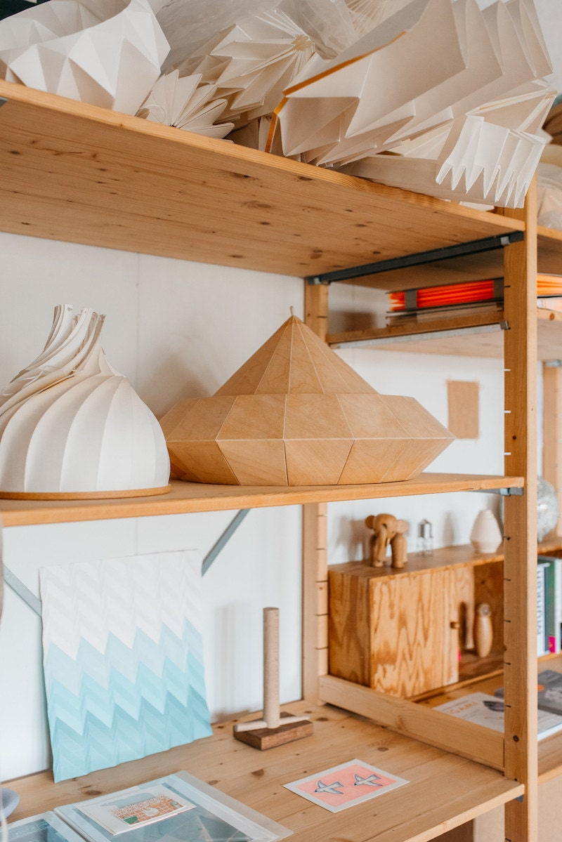 Shelves in the Nellianna studio hold an array of lamps-in-progress