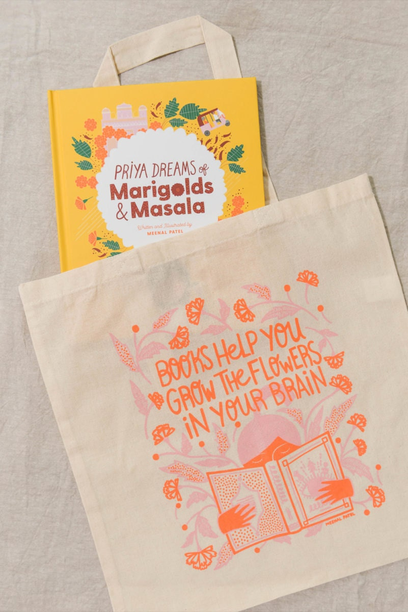 """Meenal's book, """"Priya Dreams of Marigolds and Masala"""" tucked into one of her """"books help you grow"""" totes"""