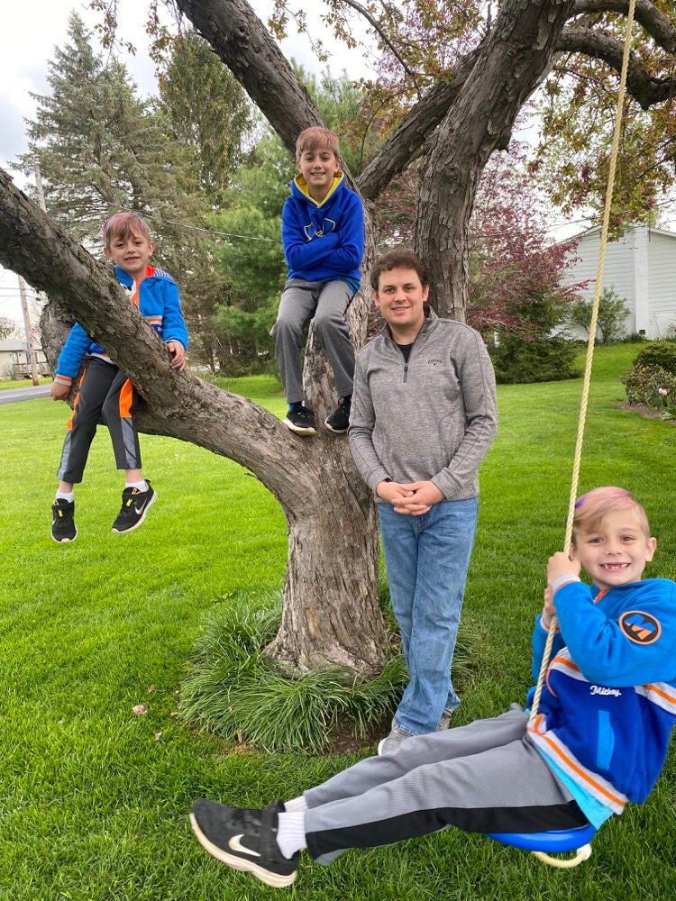 A portrait of Case Mediation Specialist Montgomery Bopp and his 3 sons.
