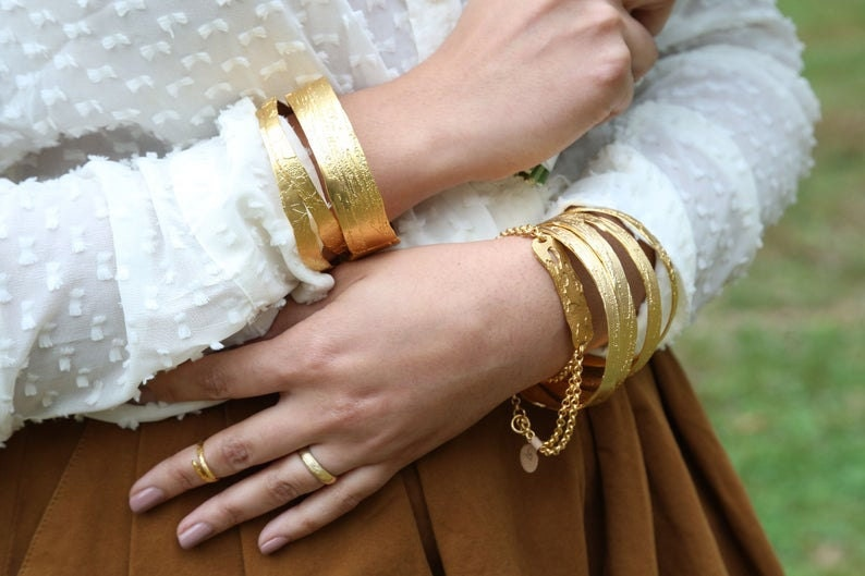 Large etched gold bangles from Lingua Nigra