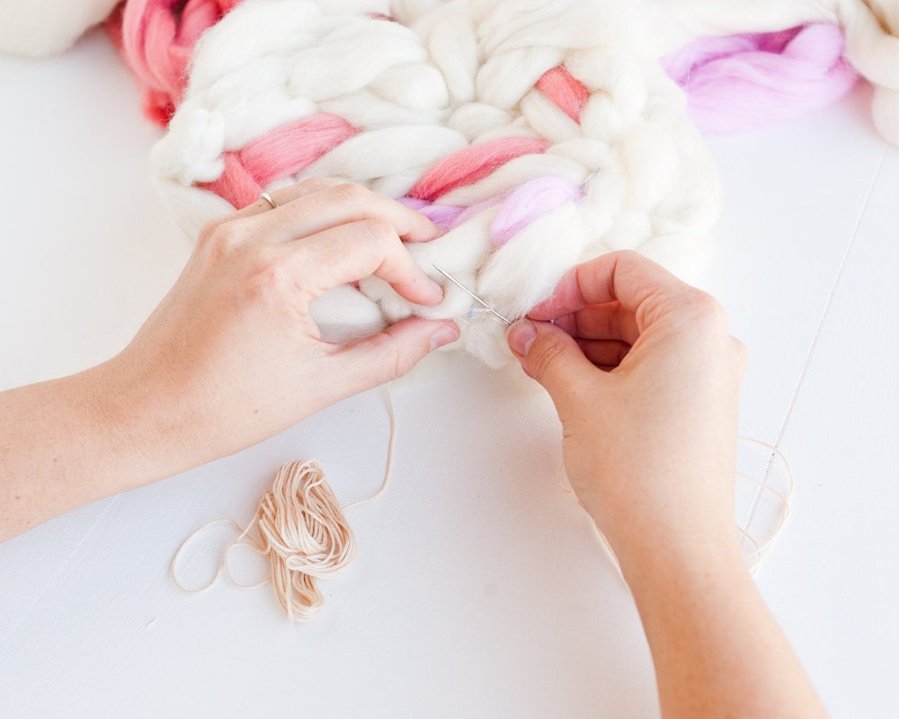 Tying the front and back circles together with embroidery floss