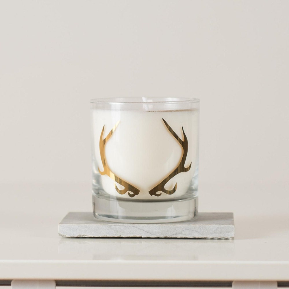 A gold antler candle from Vital Industries