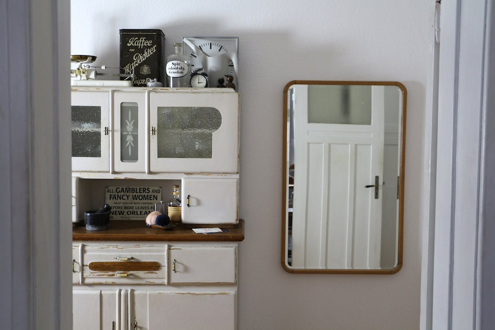 Vintage items arranged on a cabinet