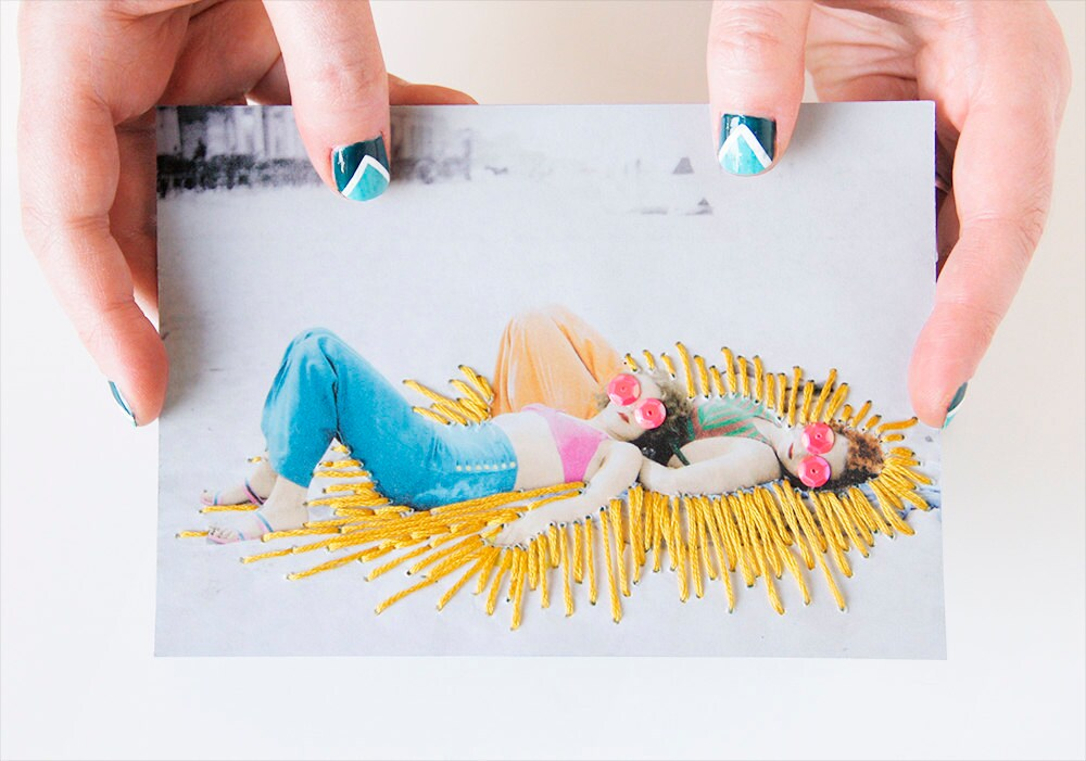 DIY embroidered photograph of two sunbathers