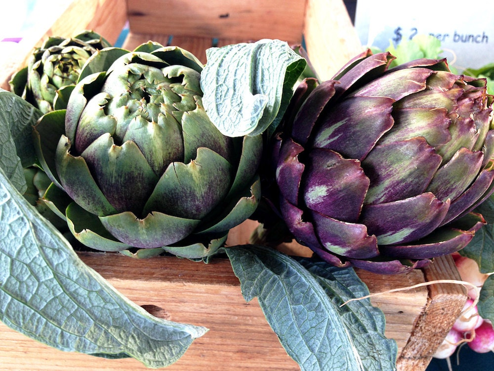 A wooden crate of artichokes