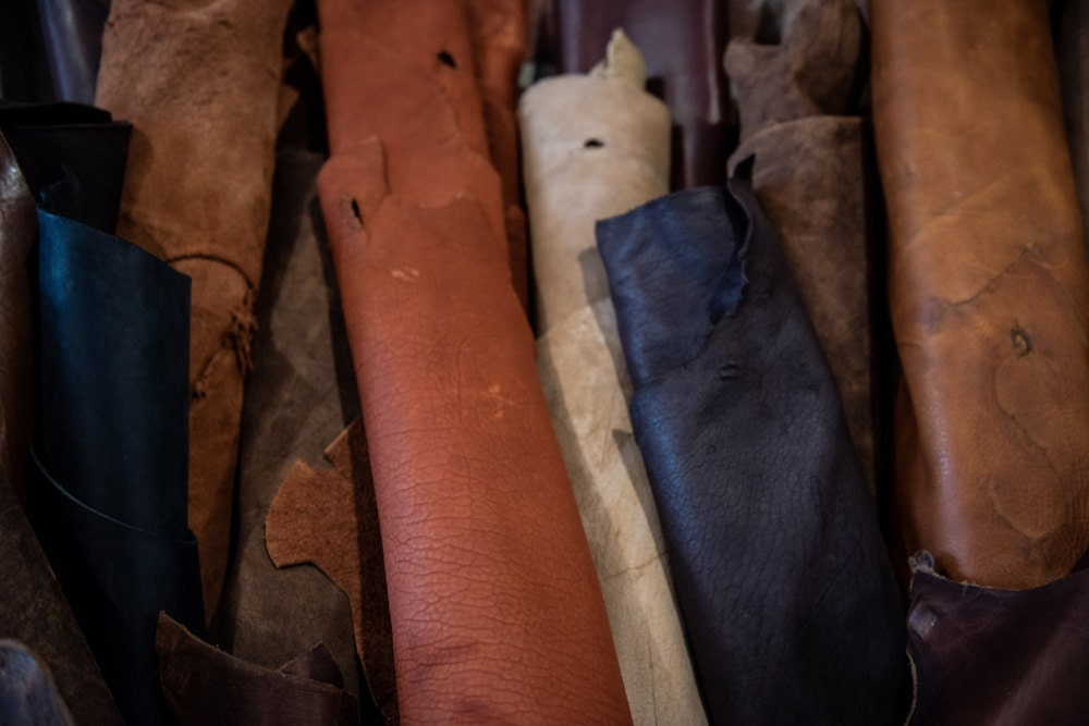Rolled up swatches of leather in various colors and grains.
