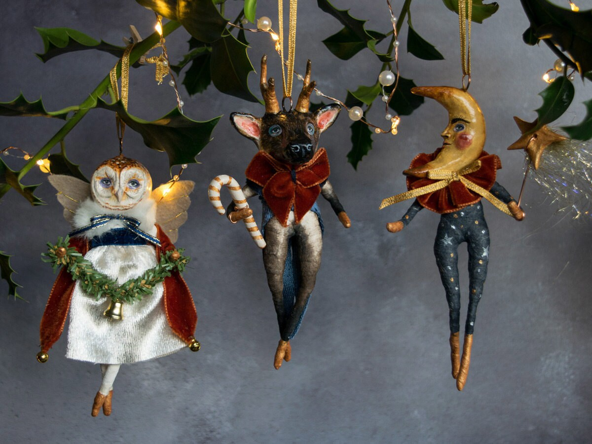 Animal ornaments from Kayleigh Radcliffe hanging from a tree