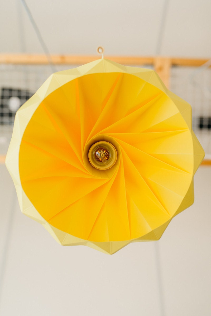 An up-close look at a yellow paper lamp from below