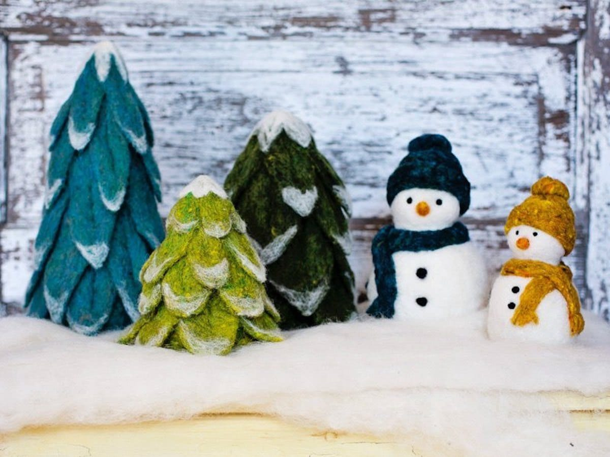 Needle felted evergreen trees and snowmen.