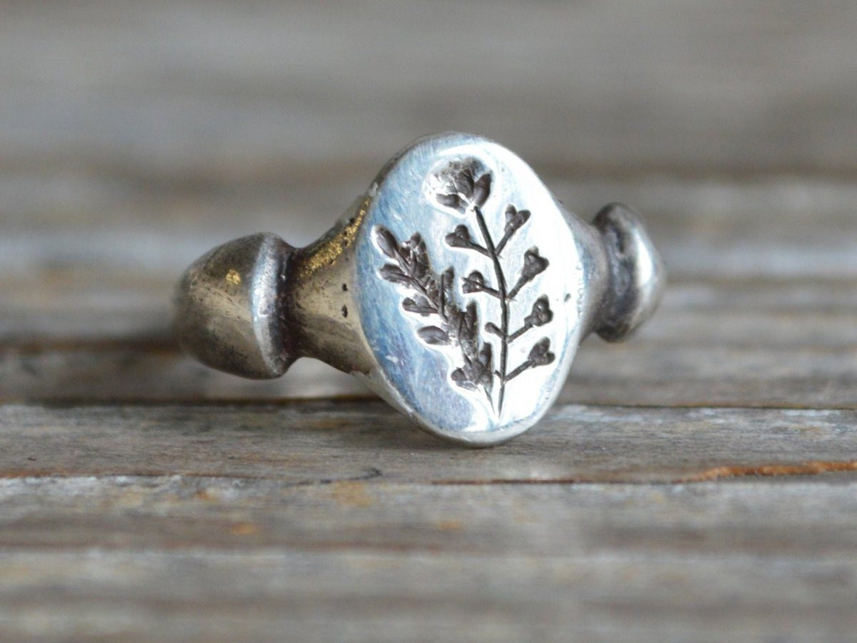 Sterling silver ring engraved with a botanical design