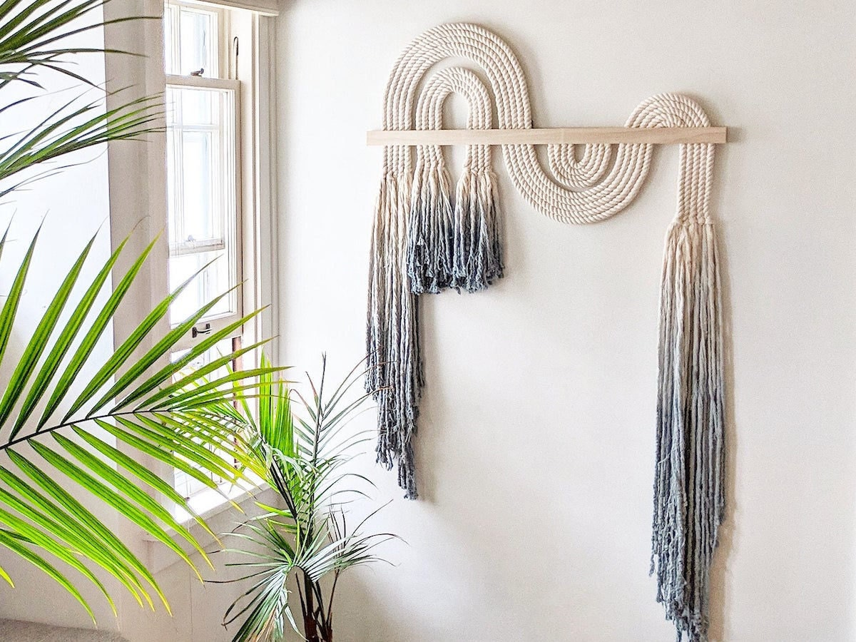 A large macrame wall hanging from Candice Luter Art + Home