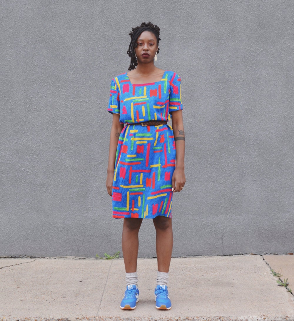 Rachelle models a colorful abstract print dress.
