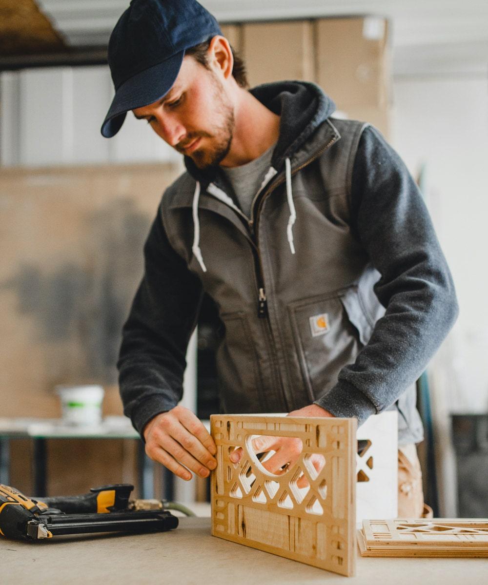 Andrew assembles a wooden milk crate.
