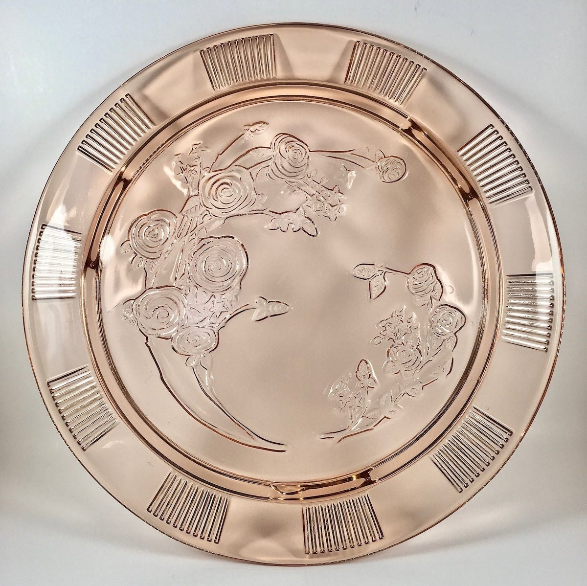 Cake plate made of pink Depression glass, from Etsy
