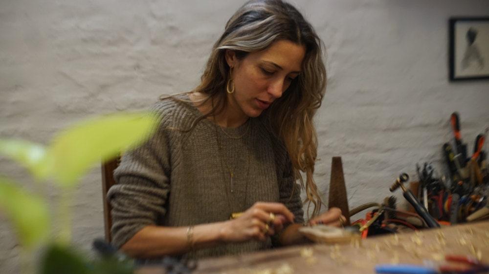 Maria Solorzano making jewelry in her studio
