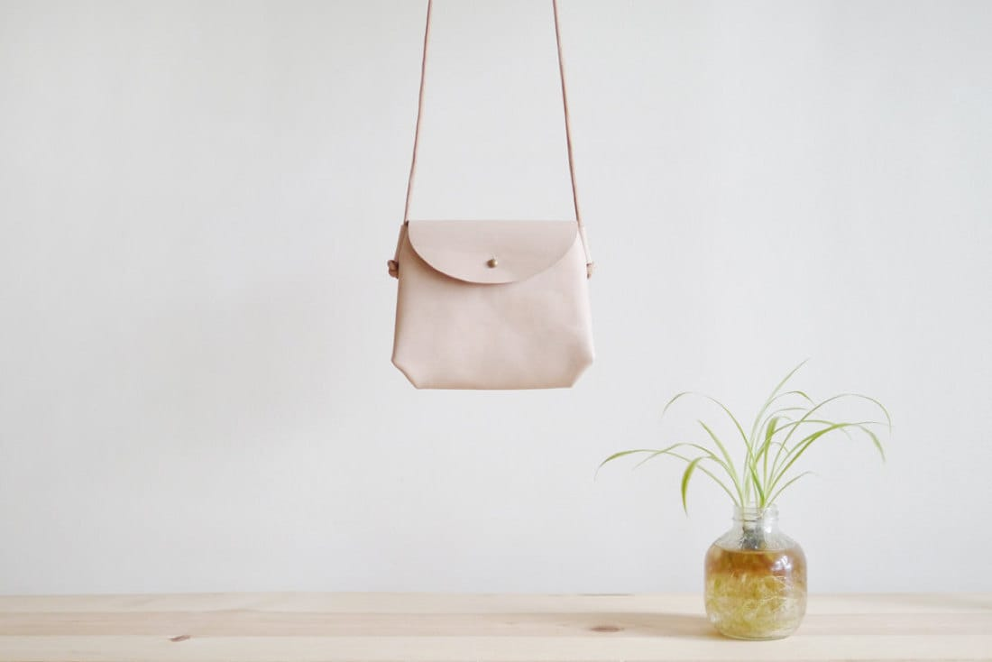 Mini crossbody sling in natural nude from Small Queue